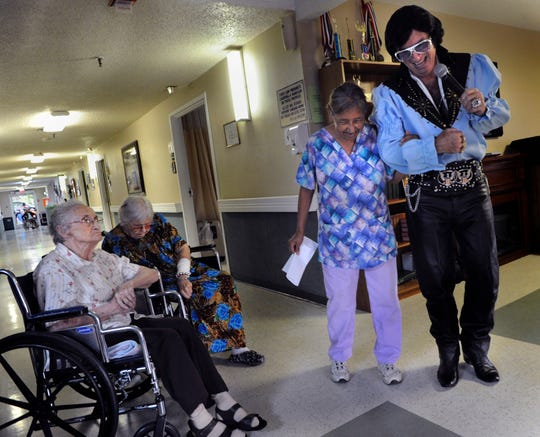 Harvey McFadden laughs with one of the workers at the Senior Citizens Nursing Home in Winters on Sept. 10, 2013.