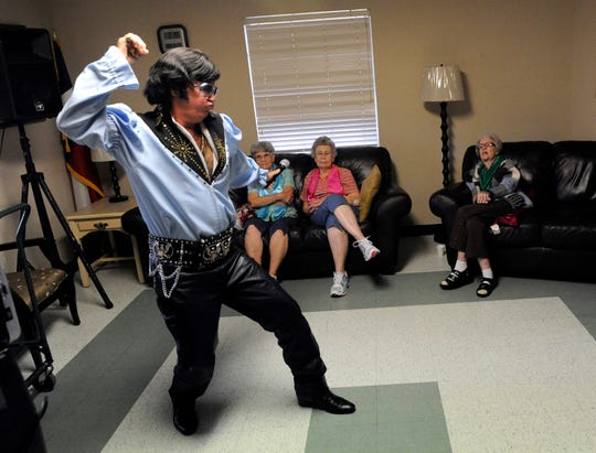 """Harvey McFadden gyrates to """"Polk Salad Annie"""" for residents at Senior Citizens Nursing Home in Winters on Sept. 10, 2013."""