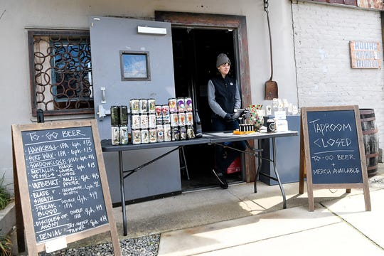 Despite being closed due to the coronavirus, Burial Beer offered cans of beer to-go March 17, 2020 in Asheville's South Slope. The brewery plans to do so until further notice.