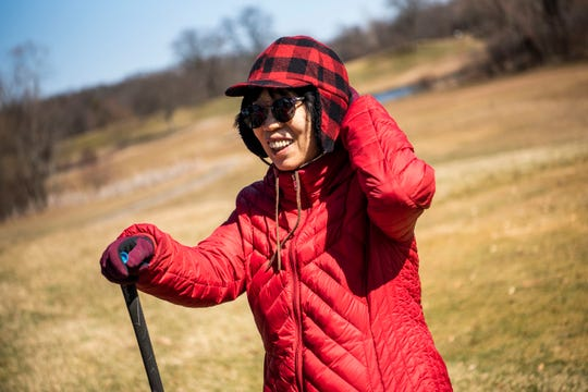 Sang Kim hangs out at Binder Park Golf Course on Tuesday, March 17, 2020 in Battle Creek, Mich. As sports come to a halt in Michigan to limit the spread of COVID-19, golf courses remain open.