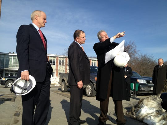 Binghamton University President Harvey Stenger, left, U.S. Rep. Richard Hanna and Larry Roma, BU associate vice president for facilities management, discuss current and future construction projects on the university's Vestal campus in 2013.