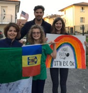 The Gordon family — from left, Ionela, Ilinca, Scott, and Delia — have been experiencing life in a locked-down Italy.