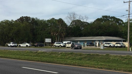 Multiple Brevard County sheriff's deputies spotted in wooded area along U.S. 1.