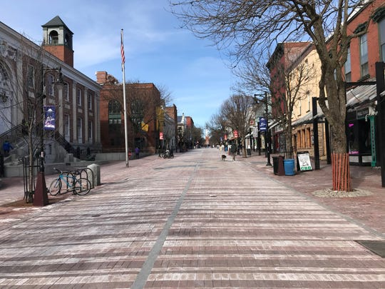 Burlington's Church Street was light on foot traffic Monday afternoon, March 16, 2020.
