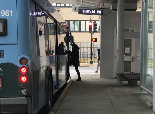 A passenger boards a Green Mountain Transit at Cherry and St. Paul streets in Burlington on March 17, 2020. Buses in the system are fare-free and run on some restricted schedules due to the rapid spread of a new coronavirus.