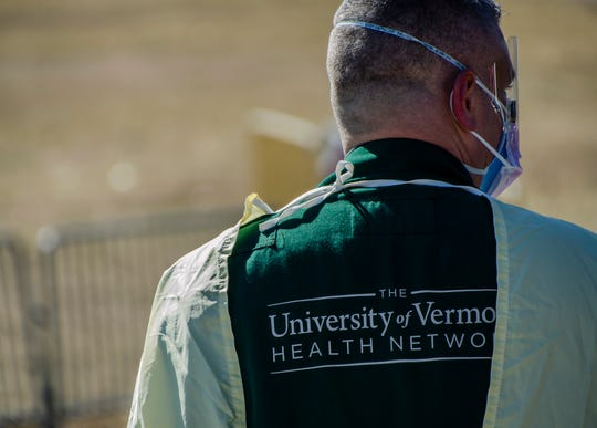 A University of Vermont Health Network critical care team conducts drive-up testing for Covid-19 at the Essex fairgrounds in Essex Junction, Vt., on Monday, March 16, 2020. Patients must be referred by their doctor to undergo testing.