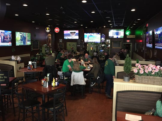 "McGillicuddy's Irish Ale House in Williston was about half full around noon for St. Patrick's Day celebrations March 17, 2020. ""It's typically one of the busiest days if not the busiest day,"" according to owner Dave Nelson, speaking two hours before a state-mandated closure of bars and restaurants because of the COVID-19 outbreak."