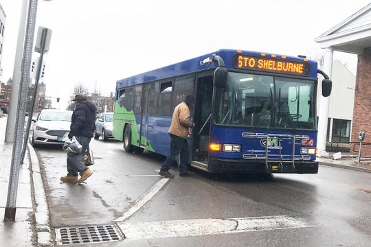 A passenger boards a Green Mountain Transit on South Winooski Avenue in Burlington on March 17, 2020. Buses in the system are fare-free and run on some restricted schedules due to the rapid spread of a new coronavirus.