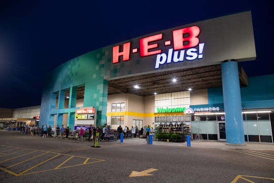 People wait in line at the HEB in Flour Bluff for the store to open at 8am on Tuesday, March 17, 2020. HEB has changed their store hours to 8:00 a.m. to 8:00 p.m to restock shelves due to people stocking up on supplies because of the COVID-19 outbreak.