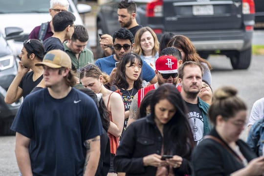 "Hundreds of people wait in line despite recommendations of ""social distancing"" at Franklin Barbecue on the eastside of Austin on Friday March 13, 2020."