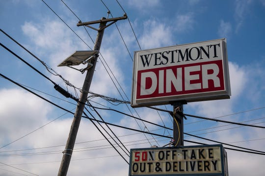 The Westmont Diner offers half-off orders as they remain open for takeout and delivery Tuesday, March 17, 2020 in Haddon Township, N.J.