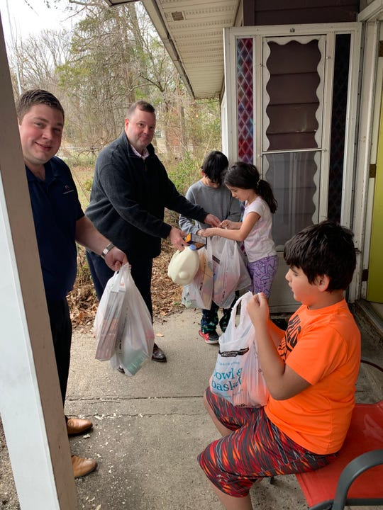 The Levine family of Somerdale receives groceries from American Construction Co. President Chris Bruner (in background) and partner Greg Dobkin,  whose company bought and donated essentials to help out many families facing special  hardships during the coronavirus pandemic.