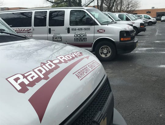 Vans sit in a parking lot outside the Pennsauken headquarters of Rapid Rover.