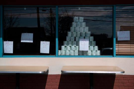 Outdoor tables are set up outside the Westmont Diner as they remain open for takeout and delivery Tuesday, March 17, 2020 in Haddon Township, N.J. The restaurant also features a small grocery section and is selling toilet paper.