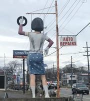 A statue outside a tire store oversees an accident scene Monday on the Black Horse Pike in Gloucester Township.