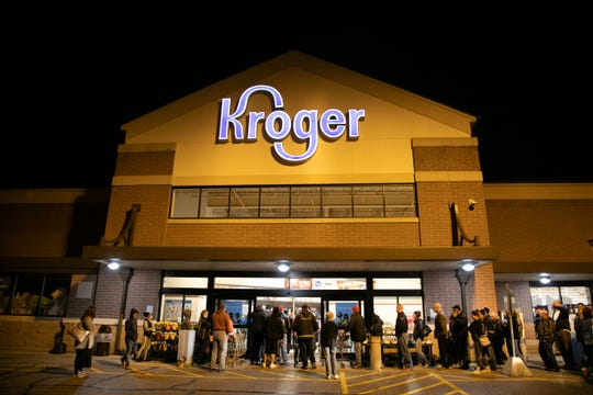 Long lines at the Kroger in Blue Ash early Tuesday as people wait for the store to open. Once the doors opened, some people were seen yelling at others they felt were cutting in line.