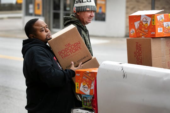 CJ Stephens, pastor of Lord's Gym, left, and Jim Johnson, a volunteer, unload more supplies at the ministry in East Price Hill, Tuesday, March 17, 2020. More people are in need due to the new coronavirus.