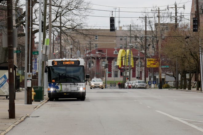 The 31 bus travels west on East McMillan Street in the East Walnut Hills neighborhood of Cincinnati on Tuesday, March 17, 2020.