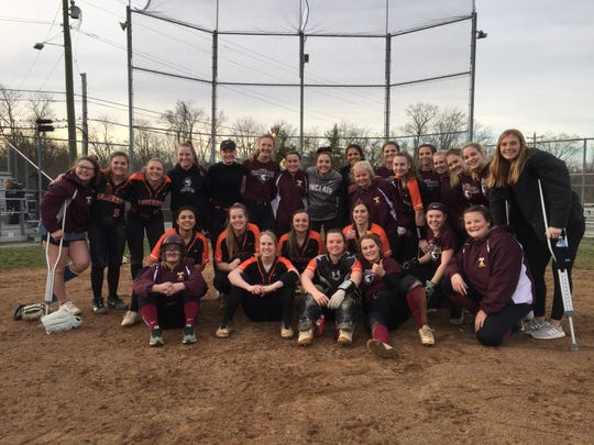 The Anderson and Turpin softball teams gather after an impromptu scrimmage March 13 before schools were closed.
