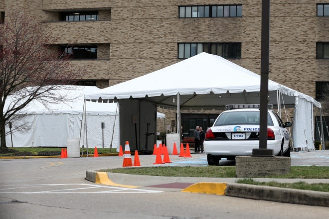 The drive-thru testing new coronavirus testing tent for UC Health. The site is off Burnet Avenue at the West Professional Building just north of Martin Luther King Jr. Drive and is a block from the main University of Cincinnati Medical Center building.