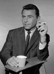 """Rod Serling pauses for a cigarette and coffee between scenes during filming of """"The Twilight Zone"""" in this 1961 file photo."""