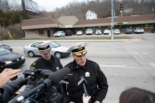 Assistant Police Chief Paul Neudigate speaks to media on Tuesday, March 17, 2020, in Cincinnati. Neudigate said that Queen City Lounge had violated Gov. Mike DeWine's order banning gatherings of more than 50 people and would be boarded up after ignoring a warning to close from the police.