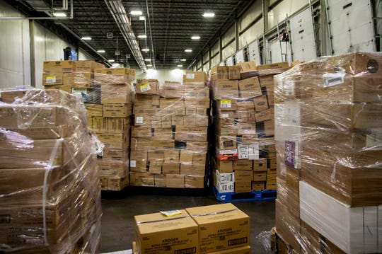 Pallets of frozen food wait to be loaded on to trucks at the Kroger's Fresh Distribution Center in Blue Ash on Tuesday, March 17, 2020. The Cincinnati Fresh Center services 105 Kroger stores in the Cincinnati, Dayton and Northern Kentucky areas.