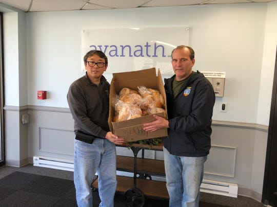Edison Board of Education member Jerry Shi and Councilman Joe Coyle delivered 50 dozen breads to seniors on Sunday.