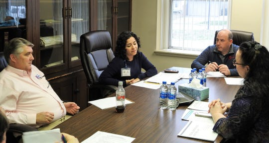 Safety Service Director Max Crown, Deputy City Health Commissioner Katherine Clark, Mayor Mark Mills and Health Commissioner Wendy Redmond discuss city response to COVID-19 at a meeting recently at city hall.