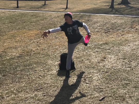 Disc golfer Luke Newstrom of Des Moines plays Tuesday at Grandview Park