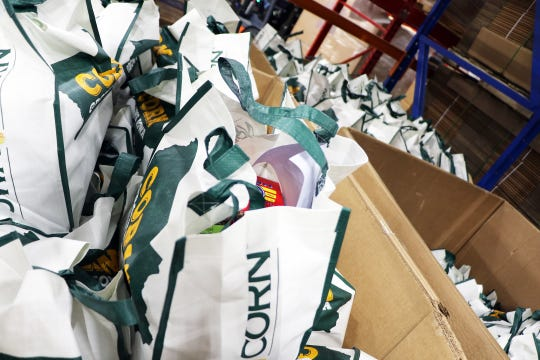 """In March, the Food Bank of Iowa and local school districts started packing 20-pound emergency bags and boxes with shelf-stable foods. But even that """"certainly won't cover all the need,"""" said the food bank's President and CEO Michelle Book."""