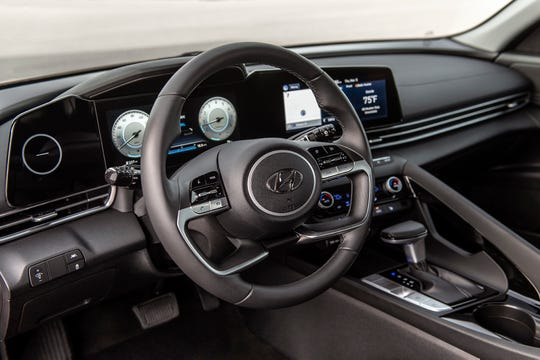 The 2021 Hyundai Elantra's interior promises more front headroom than the current model, and an optional 10.25-inch infotainment touch screen.