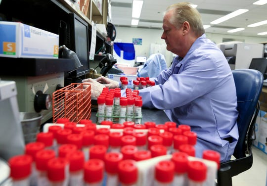 Clark Drobek, 62 of Warren processes patient swabs to test for the Coronavirus COVID-19 at Henry Ford Hospital in Detroit, Michigan on Tuesday, March 17, 2020.