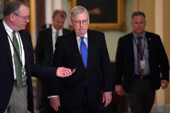 Senate Majority Leader Mitch McConnell of Ky., walks back to his office on Capitol Hill in Washington, Tuesday, March 17, 2020.