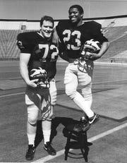 "University of Michigan offensive lineman John ""Jumbo"" Elliott and running back Jamie Morris."