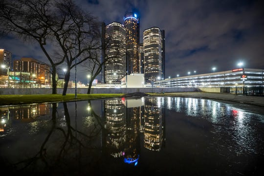 The Renaissance Center, home to the world headquarters of General Motors Co., is reflected near Hart Plaza.