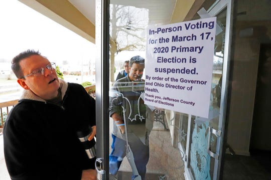 Jefferson County Elections officials arrive to pack up the polling place at Our Lady of Lourdes church in Wintersville, Ohio, Tuesday, March 17, 2020. Ohio's presidential primary was postponed Tuesday amid coronavirus concerns.