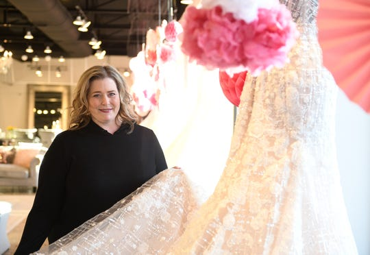 Owner Michelle McFarland is pictured at The Wedding Shoppe in Berkley on March 17, 2020. McFarland is helping brides deal with the challenges as some brides and couples are in limbo as many venues for weddings are closing or are closed already.