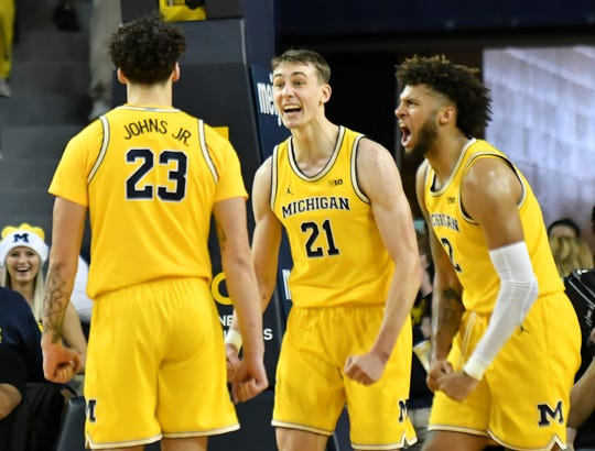 Michigan's Franz Wagner (21), Isaiah Livers (right), and Brandon Johns Jr. (23) all could be back next season.