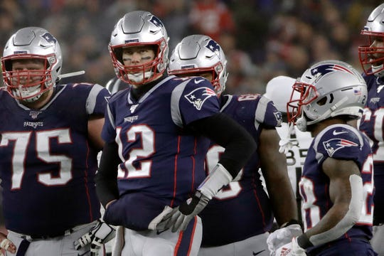 Quarterback Tom Brady has spent 20 seasons with the New England Patriots after a collegiate career at Michigan.
