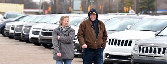 Jennifer Creet, and her husband, Kerry, both of Troy, shop for a used vehicle at Matthews Hargreaves Chevrolet in Royal Oak on Tuesday.