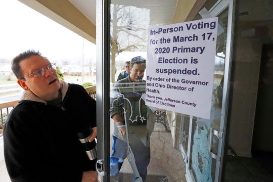 Jefferson County Elections arrive to pack up the polling place at Our Lady of Lourdes church in Wintersville, Ohio, Tuesday, March 17, 2020. Ohio's primary voting was postponed amid coronavirus concerns.