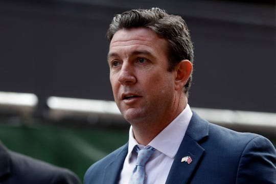 Convicted ex-Rep. Duncan Hunter leaves a court building after his sentencing Tuesday in San Diego. Hunter has been sentenced to 11 months in prison after pleading guilty to misspending campaign funds.