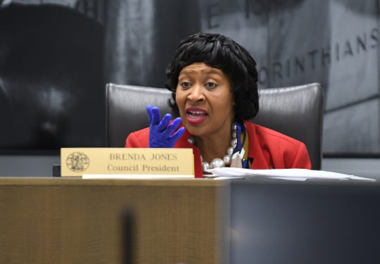 Detroit City Council President Brenda Jones uses protective gloves as she conducts council business during a regular meeting in their chamber, Tuesday, March, 17, 2020.