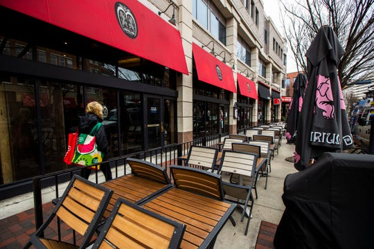A downtown Bethesda, Md. restaurant is closed as Maryland Gov. Larry Hogan's executive order takes effect, closing bars, restaurants, gyms and movie theaters across the state in response to coronavirus, Monday, March 16, 2020.