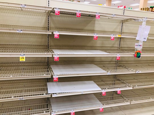 A bread shelf stands empty at a Schnucks grocery store in Evansville on Monday.