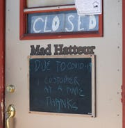 A sign on the door of Mad Hatteur on South Main Street Tuesday, March 17, 2020, in Fond du Lac, Wis., announces customer quantity restrictions during the COVID-19 pandemic affecting the world.