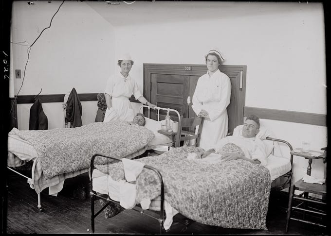 Nurses pose with two patients in a makeshift hospital at Colorado Agricultural College during the 1918-19 Spanish flu pandemic. The virus first came to the campus in October 1918 and was known to particularly target young people.<br /> <br /> &nbsp;