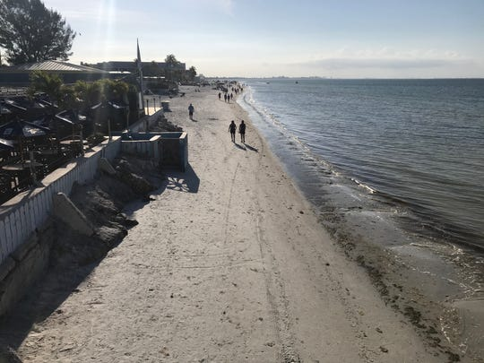 Fort Myers Beach Town Manager Roger Helmstadt on Monday suspended the permits of beach vendors including parasails, jet skis chair rentals. Aove, an area usually filled with parasail, waverunner and chair rental kiosks sits empty Tuesday.
