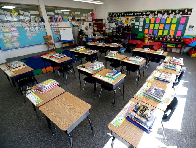 Books and other learning materials organized by Carrie Korinek, second-grade teacher at Notre Dame School of De Pere, sit ready for students to pick up and take home on March 17, 2020. Schools in Wisconsin are closing indefinitely in an effort to slow the spread of the novel coronavirus COVID-19.